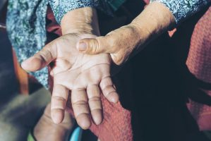 Elderly woman suffering from pain in hand.selective focus